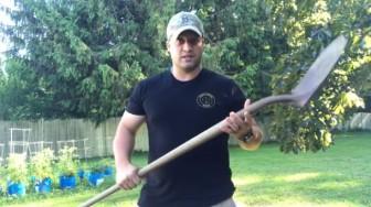 Dr. Cameron Carlson wielding a shovel